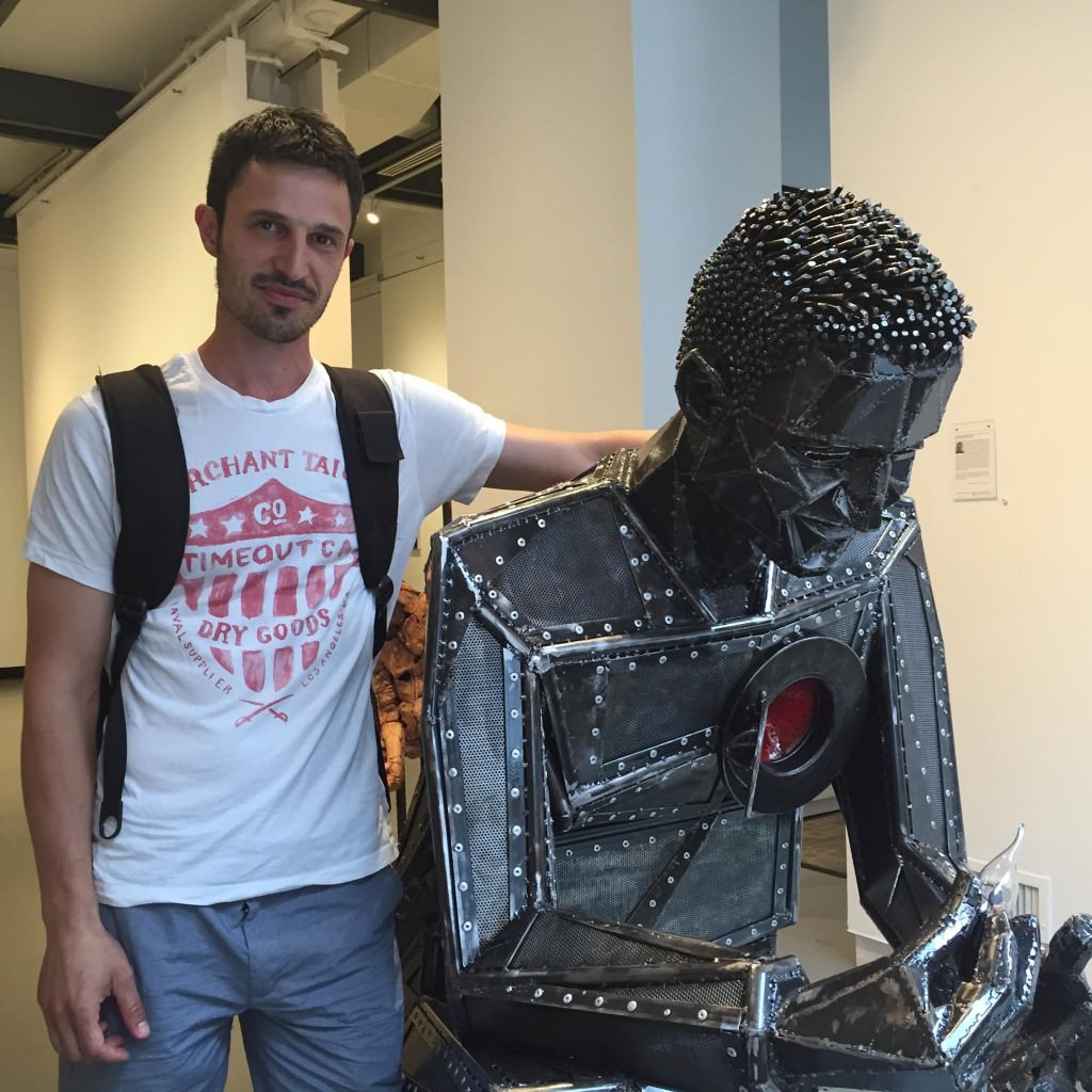 "Branko Miskovic and his sculpture ""Light in my Heart"""