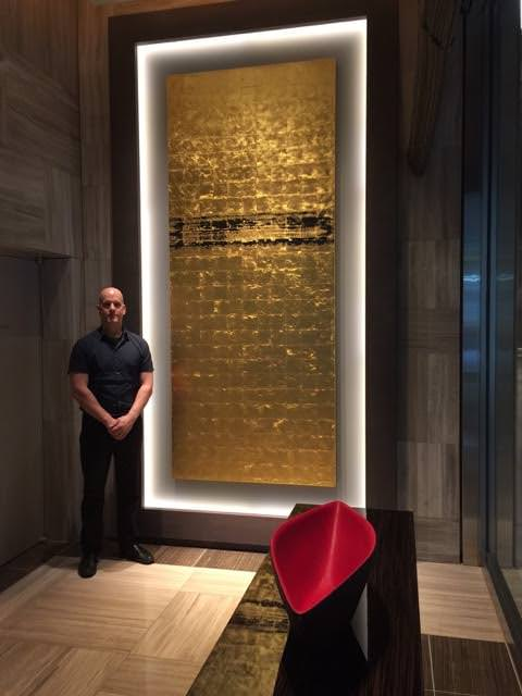 David Stanley Hewett with one of his works in the first floor lobby at The Oakwood Premier Tokyo