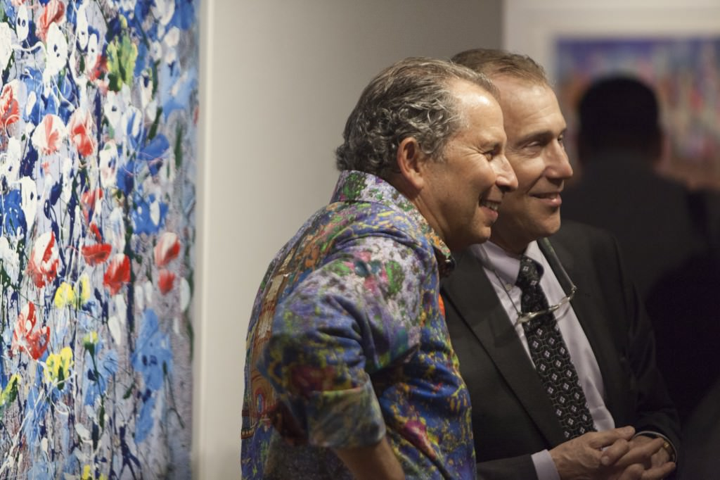 Artist Mark Schiff with guest at opening reception