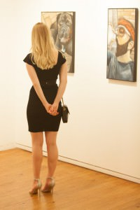One fashion that never seems to go out of style at gallery receptions is the little black dress.
