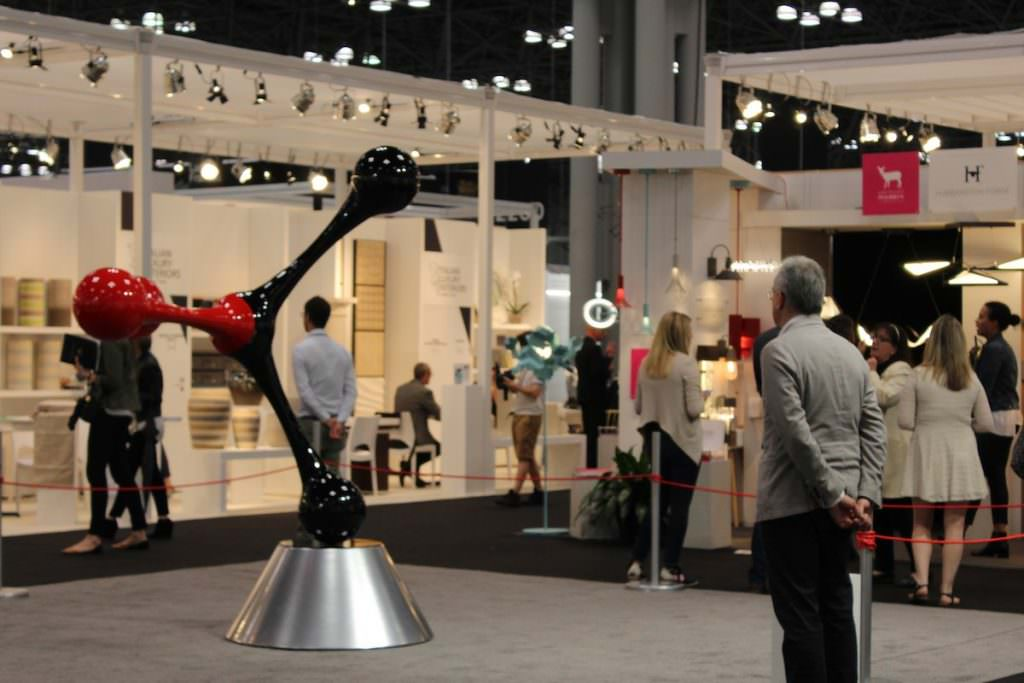 Visitor admiring kinetic work during ICFF 2017