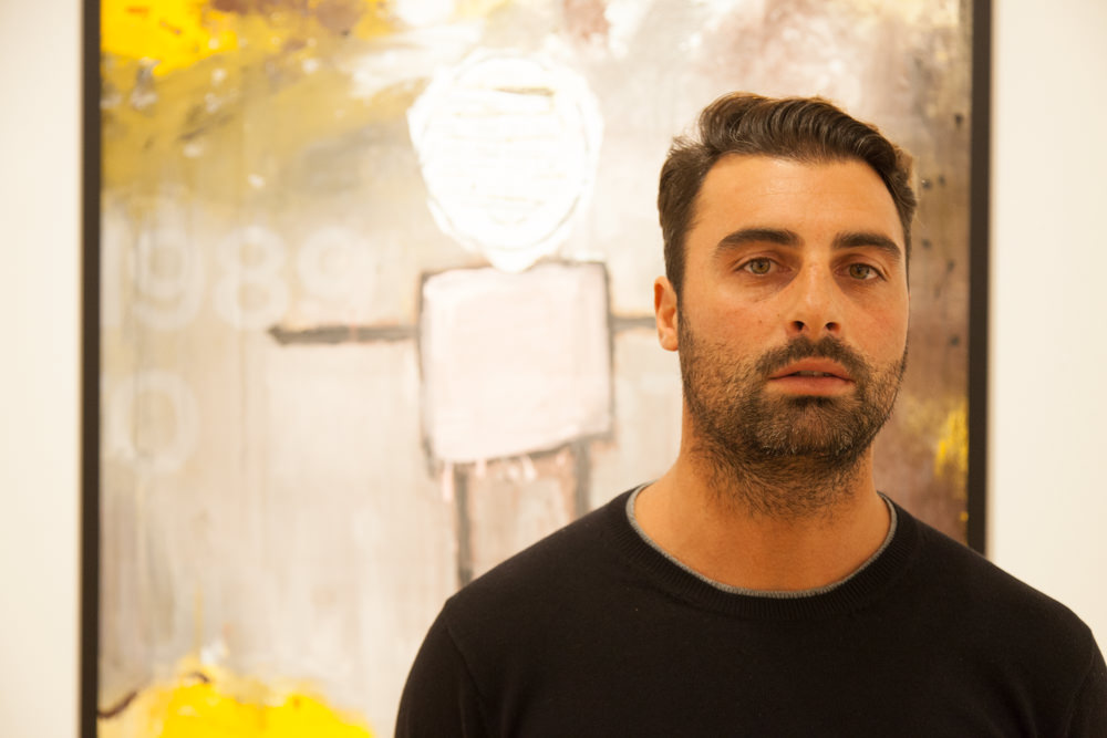 """Rocco Cardinale and his work, """"Good Karma Sold Out"""" at the December 3rd reception"""