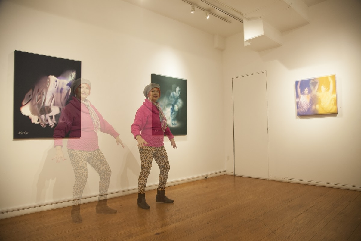 Recreating the concept of her work with the help of our photographer, Esther Insa poses in front of her works