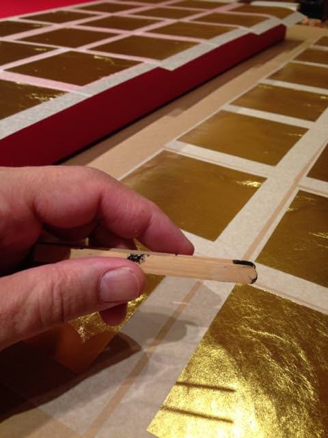 Working with goldleaf for a painting