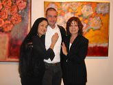 Actress Sonia Braga, Artist Vitor Azambuja, and Gallery Director Angela Di Bello in front of Azambuja
