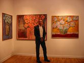 "Artist Vitor Azambuja in front of his work, ""Autumn"" and ""At 5:30am, I Water My Flowers"""