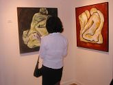 A collector admires two of Sabrina Villasenor
