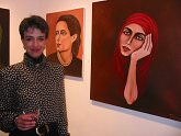 "Francesca Rota-Loiseau infront of her two paintings, ""Emma Lucia"" and ""Fuego"""