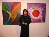 "Susana Bonnet in front of her work,""Ultimo Vuelo"" and ""La Sociedad de Consumo"""